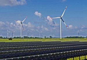 hybrid wind and solar farm on a bright sunny day